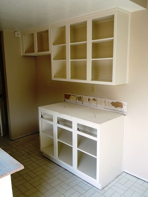 These cabinets have just been painted Antique White.