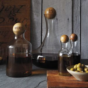 glass bottles with wood stoppers.