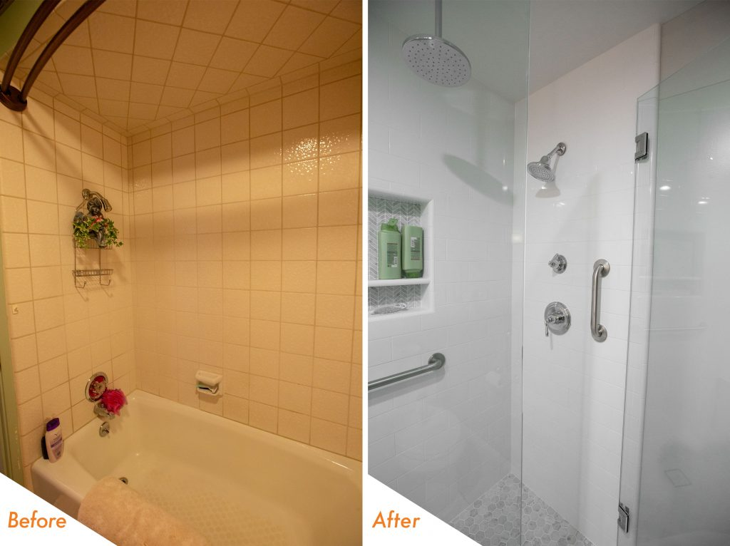 custom shower with a bench and glass enclosure.